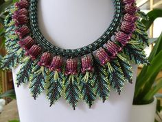 Tropical Flowers and Leaves, Bead Woven Necklace, Red/Violet Flowers.  I can so appreciate the beading but too much going on for me to wear without modifying.  dig 6/2014