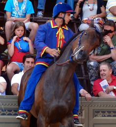 It's hard to control the wild stallion when they're congregated. Il Palio di Siena.