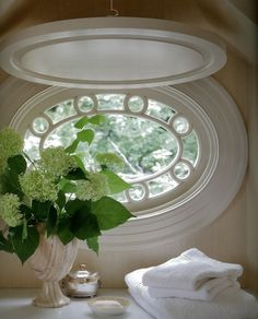 Vignette in the bath ~ pretty oval window love the little window & the shutter you can let down...