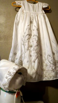 My daughter's christening gown. I had this gown, bonnet and over coat sewn from my wedding dress. It was a wonderful way to honor our wedding day and turn my wedding dress into a family heirloom. I hope this inspires more people to make an heirloom and start such a beautiful family tradition!
