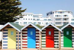 Colourful beach huts: St Moritz Hotel in Cornwall, United Kingdom | smithandfamily.co.uk