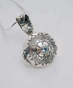 Sterling silver and blue topaz hinged locket by annamcdade on Etsy, $180.00
