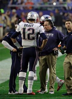 New England Patriots quarterback Tom Brady (12) speaks to coach Bill Belichick during the first half of NFL Super Bowl XLIX football game Sunday, Feb. 1, 2015, in Glendale, Ariz. (AP Photo/Elise Amendola)