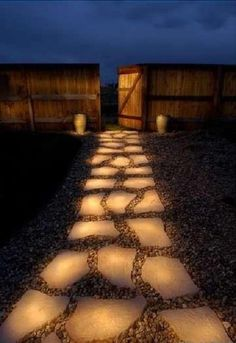 """This is the DIY version of the glow stone path. Simply paint your stone pathway with glow in the dark paint. It will """"charge up"""" during the day, to give this effect at night. http://rock.ly/9jwsd"""
