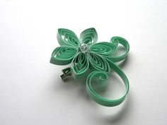 Quilling as jewelry: flower brooch / hair clip by Miaettia Creations on artfire.com