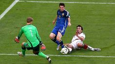 Lionel Messi of Argentina is challenged by Mats Hummels