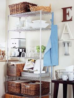I love the open shelving. The mix of industrial metal shelving and old home style boxes and baskets! (they carry this at home depot. I have a small shelving unit in my class. Wanting to use it in my home) Industrial Metal Shelving, Wire Shelving Units, Metal Shelves, Open Shelving, Kitchen Industrial, Wire Shelving Kitchen, Metro Shelving, Small Shelves, Small Kitchen Storage