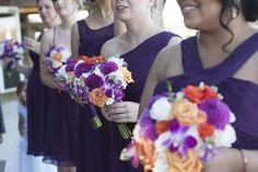 Vibrant purple, orange and white bridesmaid bouquets from Seasonal Celebrations. Photo by Deanna Graham Photography. Venue: Cinnabar Hills Golf Club, San Jose, CA.