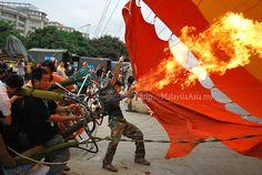 Putrajaya Hot Air Balloon Festival - Firing up a balloon. Putrajaya is a Federal Territory in Malaysia.