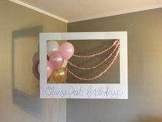 gold and pink first birthday photo booth // via tandeminlove.com