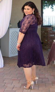 Our plus size Swinging Symphony Dress is a beautiful choice for a semi-formal wedding.  Vibrant purple lace gives just enough elegance, while the shorter length gives a cocktail look.  Find more wedding guest options at www.kiyonna.com.  #KiyonnaPlusYou  #MadeintheUSA