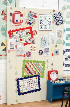 mini-quilts wall | Bulletin-board by camille roskelley