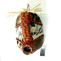 Shop our collection of beautiful textile African masks, handmade from upcycled containers and embellished with an assortment of local fabrics and other media by local artisans in Hout Bay, South Africa.
