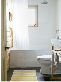 decorology: the subway tile around the tub and the natural wood paneling for an accent wall. Super cute.