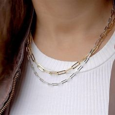 If you close your eyes and think of the words, 'chain jewelry,' you might have visions of chunky, attention-grabbing gold links adorning the necks of celebrities like Mr. T. A single chain looks great worn with a plain white T-shirt – or layer Gold and Silver together for a more complex aesthetic. Fall Jewelry, Chain Jewelry, Gemstone Jewelry, Silver Jewelry, Plain White T Shirt, Everyday Rings, Signature Style, Looks Great, Fashion Inspiration