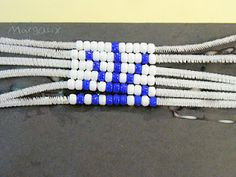 simplified wampum belts for young kids, using a pattern (kid designed) and pipe cleaners instead of weaving