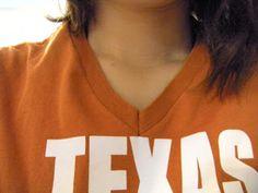 T-shirt refashion ideas: How to turn a high necked t-shirt into a v-neck t-shirt with the original neckline.