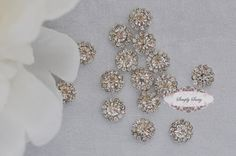 Dainty 20pcs 10mm RD173 Clear  Rhinestone Embellishment Flatback Crystal Buttons Wedding Bridal bouquets invitations favors hair. $12.50, via Etsy.