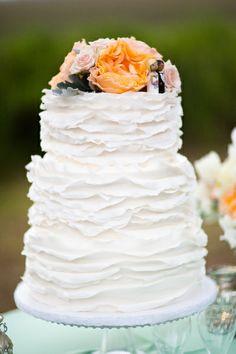white wedding cake with simple ruffles #weddingcake #whiteweddingcake #weddingcakeideas http://www.pureluxebride.com/