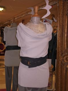 Be at Bliss in a cowl-neck top and thick, contrasting belt to top it off