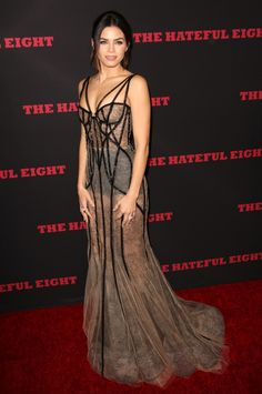 Jenna Dewan Tatum arriving on the red carpet of the Hollywood California premiere of The Hateful Eight on December 7, 2015. The Marchesa Spring 2016 Collection gown features a sheer nude fabric with a lacy pattern adding a shadow of detail throughout. The dress is lined with an intricate interplay of black sheer piping with beaded embellishments that resembles a full-body corset. The sexiness continues at the neckline, with strappy cut-outs and bra-like outlines that leave little to be…