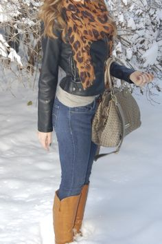 Leather jacket, leopard scarf, skinny jeans, tan boots.