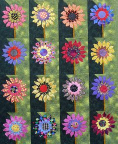 Polka Dot Daisies A cheery quilt by Sandra Krystalowich of Calgary. It must have taken countless days because each daisy is different. Photographed at Heritage Park Quilting Projects, Quilting Designs, Dresden Plate Quilts, Dresden Plate Patterns, Sunflower Quilts, Applique Quilts, Batik Quilts, Decoupage, Fabric Art