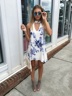 Blue & white floral represents in this beautiful choker shift dress! -Lined