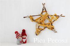 Estrella de Navidad hecha con palos y cordel / Christmas star made with sticks and string