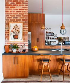Woodwork in a warm hue and some ranch house flavor by way of brick make for one of the most inviting kitchens we've seen. Wood accents like pendants and barstools steer the kitchen firmly out of of Brady Bunch territory (not a trace of veneer here), but there is something just a little bit nostalgic about the vibe. Via The Design Files. (Pin)