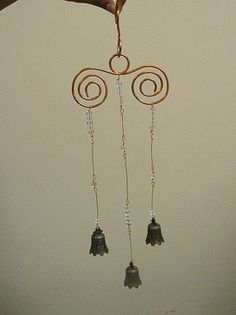 Bell, Bead and Wire Wind Chime    Create a beautiful wind chime by using heavy gauge copper wire, coins and bells.