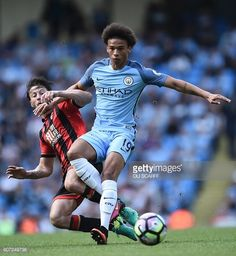 Manchester City's German midfielder Leroy Sane vies with Bournemouth's Englishborn Irish midfielder Harry Arter during the English Premier League...