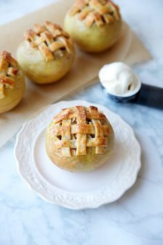 Apple Pie Baked Apples | This adorable dessert offers all the flavors and aroma of a warm apple pie, pre-portioned into single-serve treats. Each apple is filled with homemade pie filling and topped with a swirl of pecan-oat crumble. The combination is so good it will have you licking the spoon. Though other varieties of crisp apples work in a pinch, we prefer Honeycrisp because they hold their shape when baked. As far as the crust goes, we love a traditional lattice, but feel free to get…