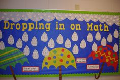 Math Objectives Bulletin Board - Each umbrella has an objective.  (ex: I can add 2-digit numbers.)  The raindrops are student examples of the objectives.