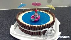 This cake was a very yummy chocolate cake with blue, vanilla butter cream icing and blue jelly for water. The outside of the pool is chocolate finger biscuits and the tiles at the pool edge are white chocolate. This cake was a huge hit with six, 3 year olds who couldn't resist sticking their fingers in the water :-)