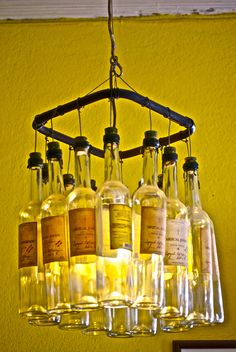 Recycled Functional Art (hanging chandelier) Mexican style with old Mezcal bottles.