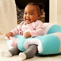 The Hugaboo leg openings are easily adjusted with snaps to customize your baby's Hugaboo experience! What a precious smile!