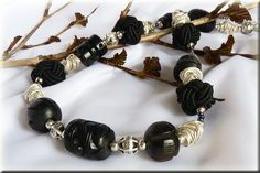 Love the black chunky beads and chaos wire wrapping.  Yummy necklace