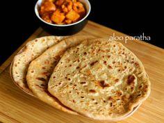 aloo paratha recipe, aloo ka paratha , alu paratha recipe with step by step photo/video. popular punjabi cuisine flat bread recipe stuffed mashed potatoes.