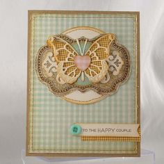 Memory Box by croppixie...layered medallion with delicate butterfly die, patterned papers, layers of other dies...