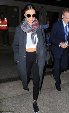 Jet-set chic:Miranda Kerr proved that she can turn heads in a simple ensemble as she flas...