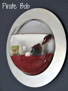 A fish tank on the wall! So dang cool!! Inspiration For Moms: A Big Boy Room Makeover Reveal!