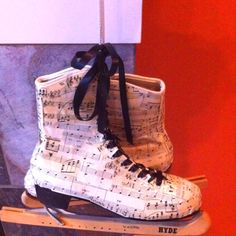 Mod podge ice skates from vintage Christmas music paper! (for a Christmas decoration)