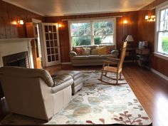 Decorating a Room with Knotty Pine Walls is part of Cottage Living Room Wood - Ever since we bought our old farmhouse, I've been slightly worried about how difficult decorating a room with knotty pine walls might be I Knotty Pine Living Room, Knotty Pine Decor, Knotty Pine Rooms, Knotty Pine Paneling, Wood Paneling Decor, Paneling Walls, Paneling Ideas, Cottage Living Rooms, Living Room Decor