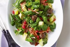 Give the traditional elements of Christmas a modern twist with this elegant meatball salad side.
