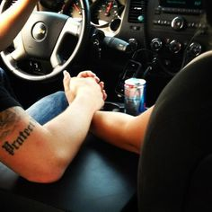 holding hands in the truck