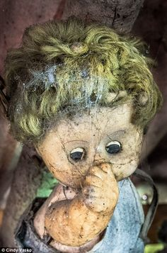 Decay: Since his death in 2001, the area known as the 'chinampas' has become a tourist hot spot where visitors hang up there own dolls (pictured)