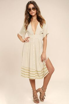 The Faithfull the Brand Mustang Beige Striped Midi Dress pairs perfectly with a sun-kissed tan and sandy toes! Beige and yellow striped woven fabric sweeps across a deep V-neck, short, butterfly sleeves, and a set-in waist with tying sash. Button-front, midi skirt (with side slits) sweeps below a tying, open back. Hidden back zipper/clasp.