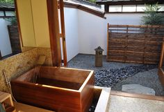 For centuries, Japanese enjoyed the country's thousands of outdoor hot springs, so it's no surprise deep soaking became popular indoors, too. Relaxing in steaming neck-high water marks the end of each day for many families, a custom catching on in the West as homeowners ask their architects for spa features such as soaking tubs and wet-proofed floors to maximize bathroom space and create a haven for relaxation. Tubs are traditionally made of Hinoki - used for centuries to build Shinto…
