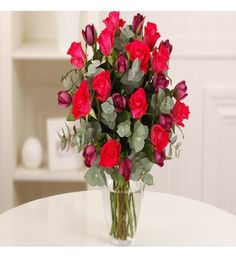 Wonderful cerise pink roses are arranged with deep purple tulips and silvery-grey eucalyptus foliage in this gorgeous bouquet which is perfect to let the love of your life know just how much you adore and appreciate her.